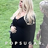 Jessica Simpson held her baby bump.