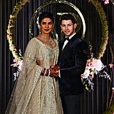 For her reception in Delhi, India, Priyanka wore a sparkly silver lehenga by Falguni Shane Peacock with a diamond necklace and earrings.