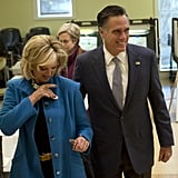 Ann proudly put on her voter's sticker beside Mitt.