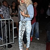 The trendsetter doubled up on denim, pairing a chambray Current/Elliott top with blooming Alexander Wang skinnies in Hollywood in March 2012. The fashion chameleon layered up in mixed metals — a gold chain bracelet, silver bar necklace, and bevy of rings — and a gray chain-strap bag, then finished off with white Alexander Wang pumps.