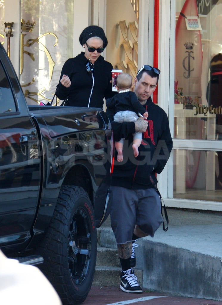 Willow Hart looked back at mom, Pink, while being carried by Carey Hart.