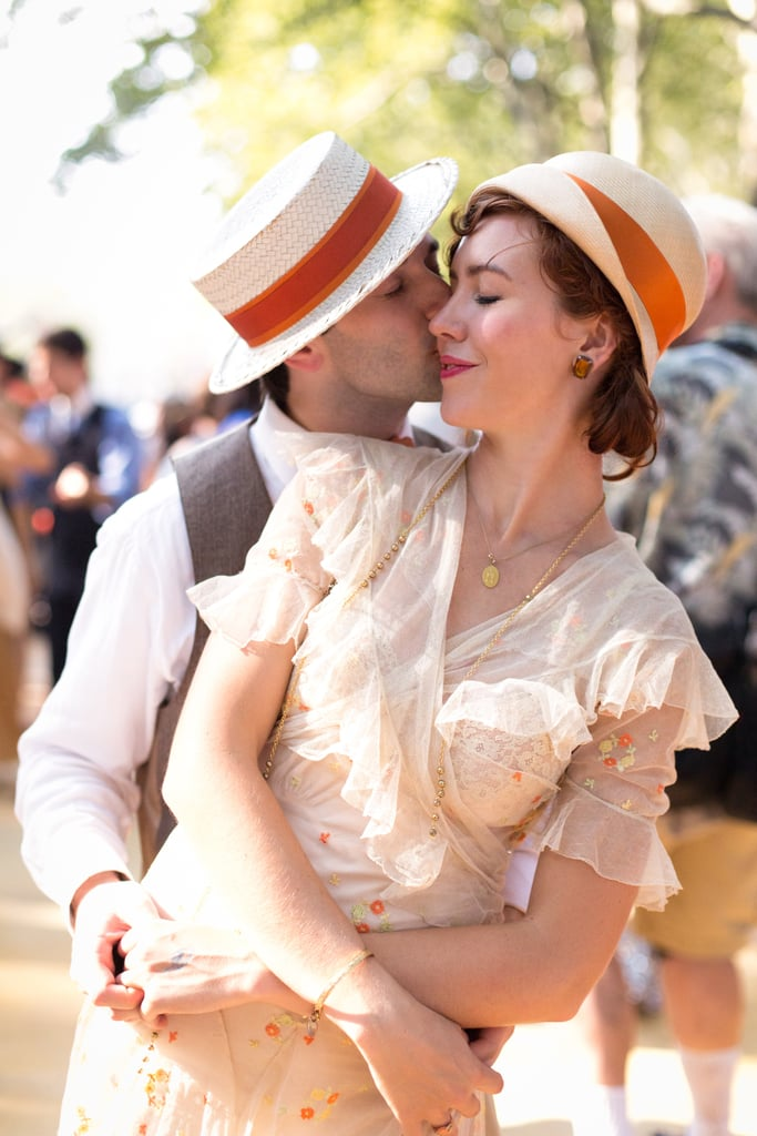 This sweet couple shared a kiss in his and hers hats and period garb. Photo: Walter Wlodarczyk