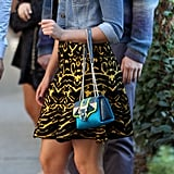 She showed off her wild side in an animal-print Torn by Ronny Kobo sweater dress ($378), a studded Topshop denim jacket, and and a lizard Paula Cademartori bag.