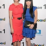 Katy Perry and Carly Rae Jepsen were matching with their raven hair and primary colours at the Billboard Women in Music lunch on November 30.