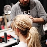 Hair was then gathered in a low ponytail at the base, and a small section was wrapped around the style to hide the elastic. Photo: Roger Kisby
