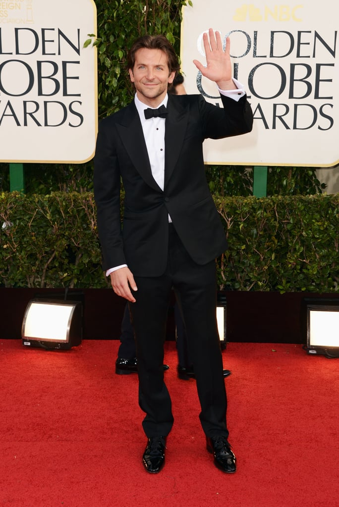 Bradley Cooper waved to the cameras in a sexy tuxedo on his way into the Golden Globes.