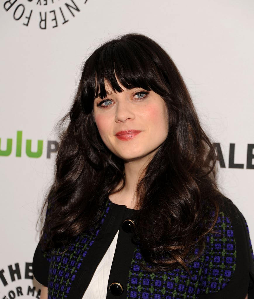 Photographers went wild when Zooey Deschanel arrived at the event.