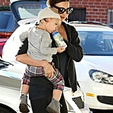 Miranda Kerr helped Flynn Bloom with his bottle.