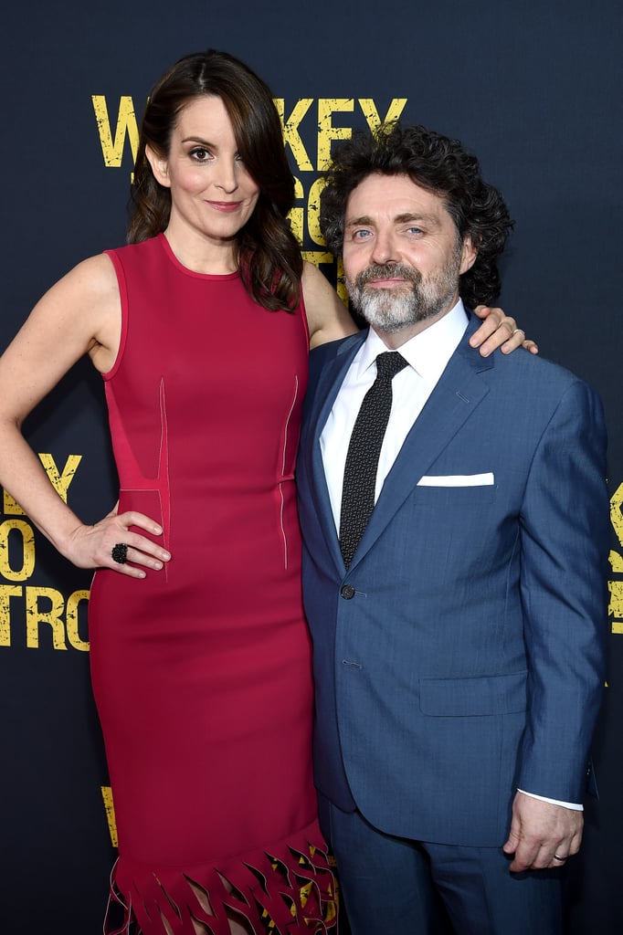 Tina Fey had the support of her other half, Jeff Richmond, at the world premiere of her new movie, Whiskey Tango Foxtrot, in NYC on Tuesday. Tina, who stunned in a red dress, smiled sweetly as she posed for photos with her husband of nearly 15 years on the red carpet. The comedy power couple first met in 1994, when they were both members of Chicago's Second City improv group, and tied the knot in 2001. Jeff even composed music for shows like Saturday Night Live and 30 Rock, on which Tina acted. They currently have two daughters together, 4-year-old Penelope Athena and 10-year-old Alice Zenobia. Keep reading to see more of Tina and Jeff's night out, and then check out even more long-term celebrity couples.