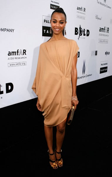 Draped in a nude creation at the amfAR's Cinema Against AIDS benefit in 2009.