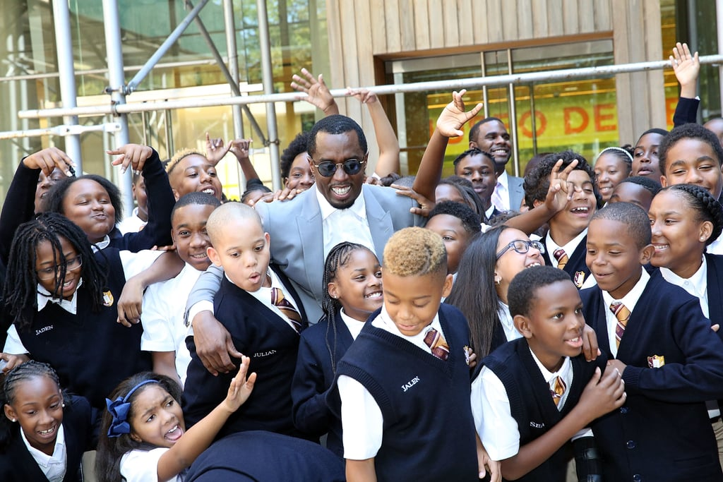 "Sean ""Diddy"" Combs was all smiles while posing with a group of excited kids while opening his Capital Prep charter school in NYC's Harlem neighborhood on Monday. The rapper and music mogul beamed with pride as he cut the ribbon and snapped photos with school officials and new students. During the big event on Monday, Diddy spoke to a crowd, saying, ""Great schools and great education make a big difference. Unfortunately, too many people don't get the opportunity to succeed, no matter how hard they try. This is leveling the playing field here at Capital Prep."" So far, the school has admitted over 170 students in sixth and seventh grades and aims to enroll about 700 more in grades six through 12 by the year 2021. News broke back in March that Diddy would be opening the school in his birthplace of Harlem, and the rapper called its creation ""a dream come true."""