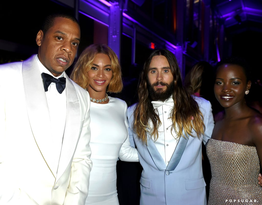 """Beyoncé and Jay Z made their way to Vanity Fair's post-Oscars bash on Sunday, making a brief appearance on the red carpet before mingling with Hollywood's hottest stars. Beyoncé wore a floor-length white dress, and inside, she linked up with everyone from her sister, Solange, to Jennifer Lopez to Jared Leto and Lupita Nyong'o. Earlier in the night, she sweetly posted a picture of Solange's Oscars outfit, writing, """"Gorgeous,"""" and during the party, she posed with Lupita's brother for an Instagram snap. Lupita wrote, """"Just introduced my brother to @beyonce. What are sisters for?!"""" Check out some must-see snaps of Beyoncé and Jay Z's night out, and then see all the stars at Vanity Fair's Oscars afterparty!"""
