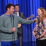 """Adam Sandler serenaded his costar and friend Drew Barrymore on The Tonight Show Starring Jimmy Fallon, singing a song called """"Every 10 Years"""" and performing """"Grow Old With You"""" from end of The Wedding Singer."""