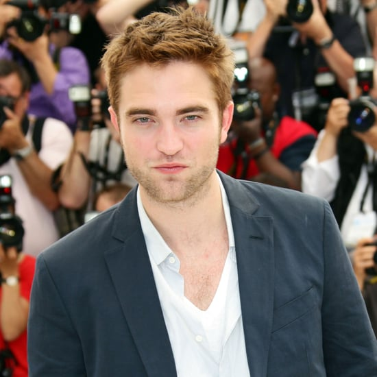 Robert Pattinson Steps Out At Cannes For The Cosmopolis Photocall