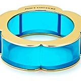 Lucite is all the rage this season, and I'm loving this Juicy Couture Wide Lucite Bangle ($30, originally $48). It's available in several widths and colors, so I'll be able to stack them up for a funky look, or throw one on for a pop of color. — Jen Michalski