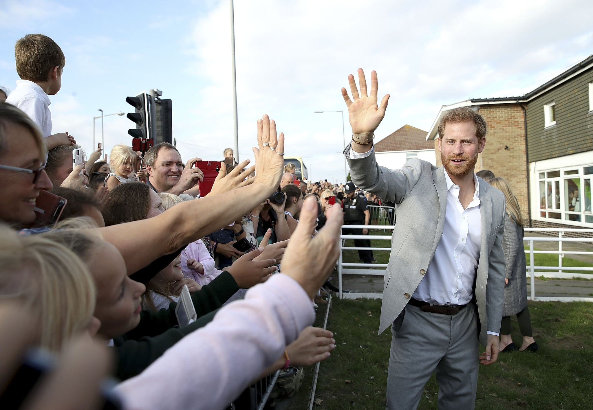PEACEHAVEN, UNITED KINGDOM - OCTOBER 03:  Prince Harry, Duke of Sussex waves to locals on an official visit to the Joff Youth Centre in Peacehaven, Sussex on October 3, 2018 in Peacehaven, United Kingdom. The Duke and Duchess married on May 19th 2018 in Windsor and were conferred The Duke & Duchess of Sussex by The Queen.  (Photo by Chris Jackson/Getty Images)
