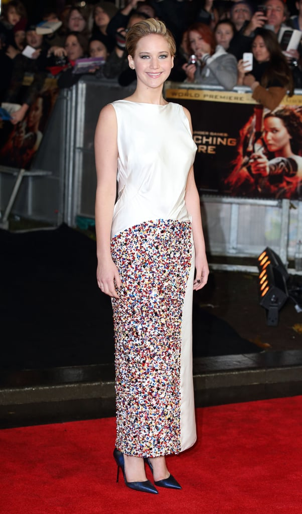 Jennifer Lawrence went with an ivory and multi-coloured embroidered silk Dior Haute Couture gown for The Hunger Games: Catching Fire's UK premiere.