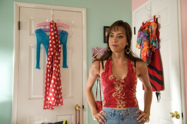 Aubrey Plaza masters the '90s-girl look with oversize earrings and a halter top.  Source: CBS Films