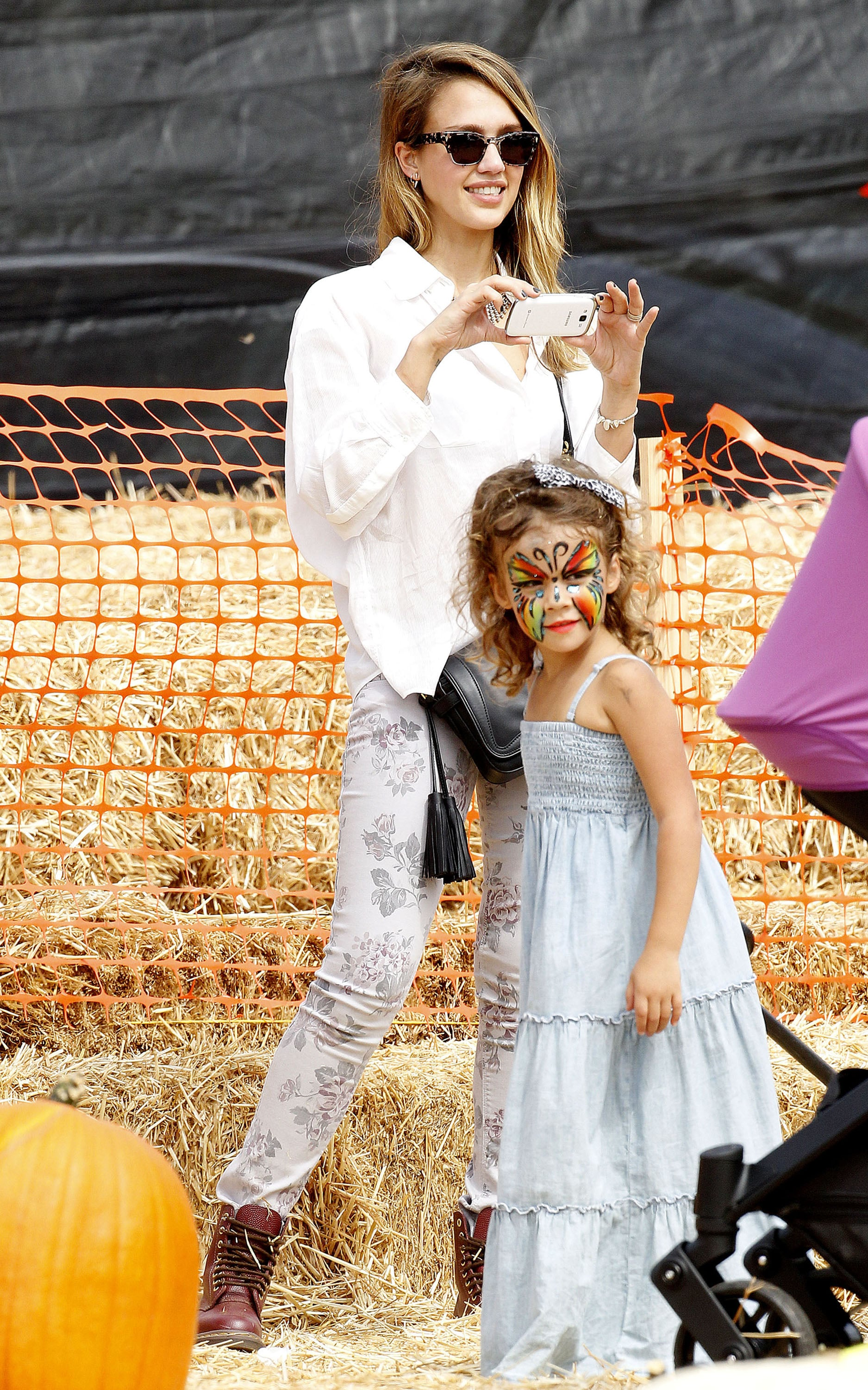 Jessica Alba snapped pictures of her family at Mr. Bones Pumpkin Patch in LA.