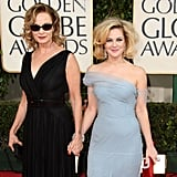 Jessica Lange and Drew Barrymore held hands on the red carpet in 2009, 26 years after Drew attended her first Golden Globes.
