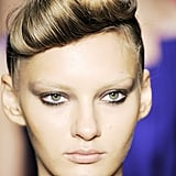 Andrew Gn's Spring 2010 models had voluminous victory-rolled bangs and smoky flicked liner.