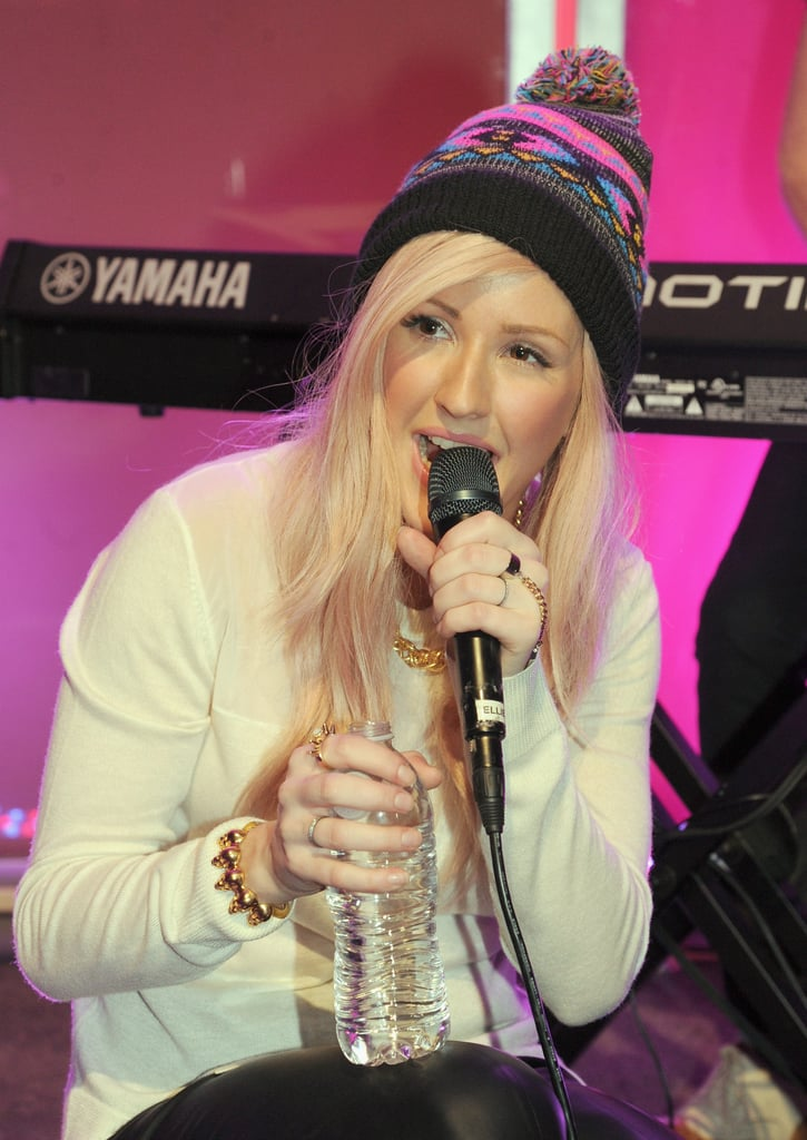 Ellie Goulding grabbed a sip of water as she catted with the audience.