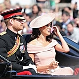For her first Trooping the Colour, Meghan stunned in a pink off-the-shoulder dress by Carolina Herrera, which she accessorized with a matching Philip Treacy hat and a clutch.