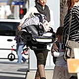 Jessica Alba carrying Haven.