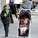 Tabitha wore pink sneakers in her stroller.