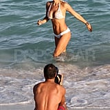 Brooke Burke in a bikini with shirtless David Charvet.