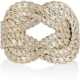 We love the unique feel of this standout cuff.  Giambattista Valli Gold-Plated Rope Cuff ($395)