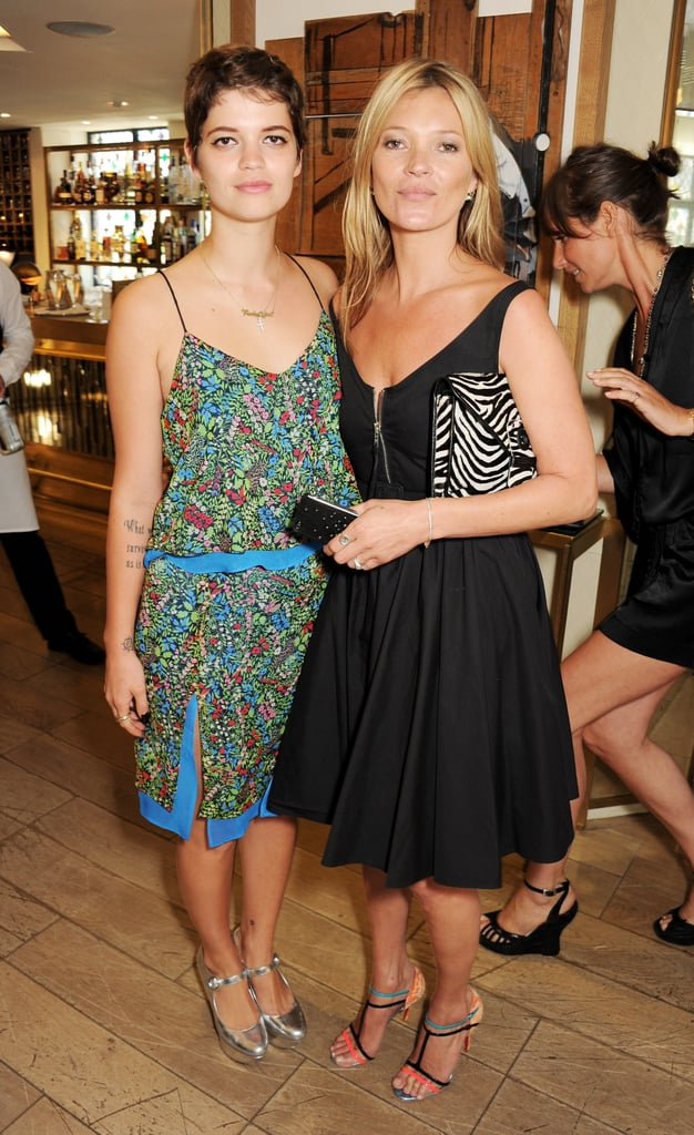 Kate Moss posed with Pixie Geldof at her tech accessories event.