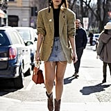 Take an unexpected route with your mini and combine cowboy boots with a structured blazer on top.