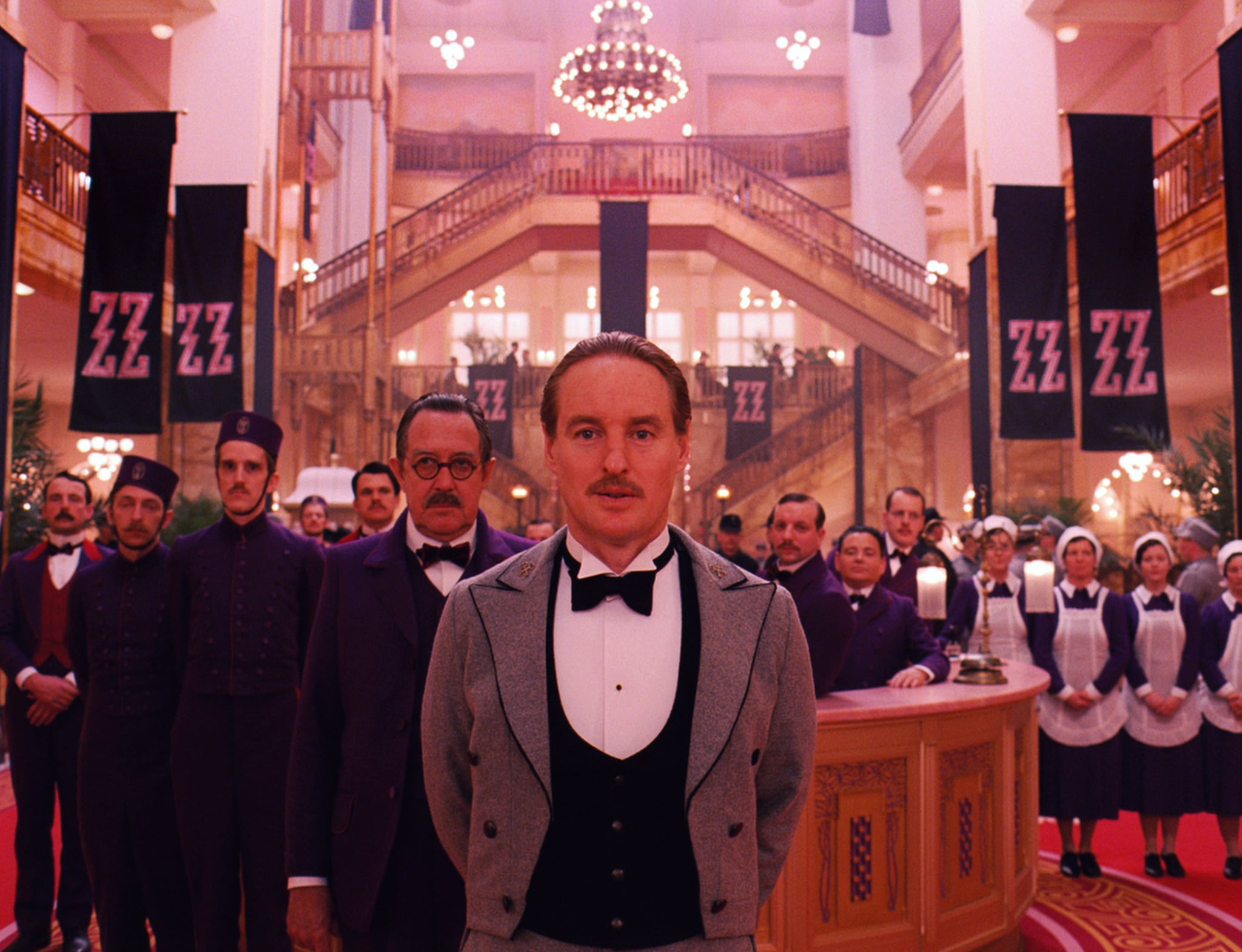 THE GRAND BUDAPEST HOTEL, Tom Wilkinson (left of center), Owen Wilson (front), 2014. /TM and Copyright Fox Searchlight Pictures/courtesy Everett Collection