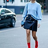 Throw on with a sweater, miniskirt, and ankle boots.