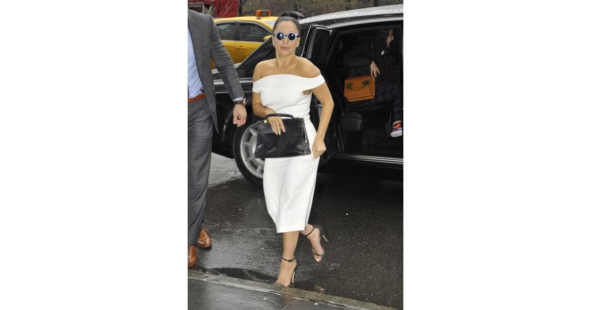 Lady Gaga wearing a white off-the-shoulder Christian Siriano midi