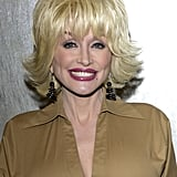 By 2002, Dolly Parton's Signature Look Had Become Flared-Out Hair With Piecey Texture