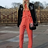 This attendee played up the sporty vibe of her draw-string pants with an athletic-inspired varsity jacket, then countered with sleek white pumps.