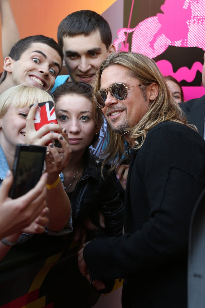 Brad Pitt took pictures with a group of fans in Russia.
