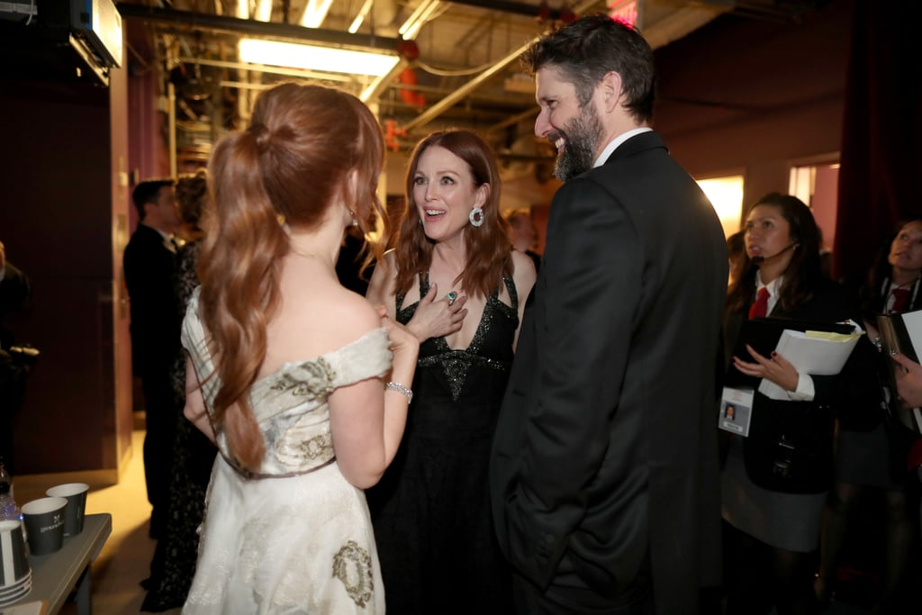 Isla Fisher linked up backstage with Julianne Moore and her husband, Bart Freundlich.