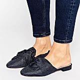 Asos's Lucky Bow Detail Ballet Mules ($34) are feminine, yet striking in dark wash denim.