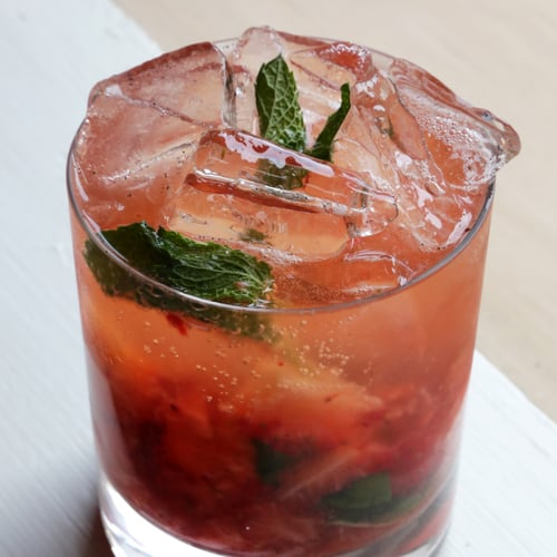 PopsugarLivingParty PlanningEasy Strawberry-Bourbon CocktailSister to the Mint Julep: A Strawberry-Bourbon CobblerApril 24, 2014 by Anna Monette Roberts5.6K SharesChat with us on Facebook Messenger. Learn what's trending across POPSUGAR.One of my favorite cocktails of all time is a Kiwi Cobbler from Food & Wine magazine. The combination of muddled fruit, mint, and vanilla bean scream warm weather and lazy weekends outside. That's why I sought to create a riff on the cocktail for the Kentucky Derby using in-season strawberries and bourbon. The flavors meld effortlessly. Thanks to the vanilla bean and strawberries, there's no need to go overboard on the sugar. Think of this as a less-sweet, fruity mint julep. Cheers!Strawberry-Bourbon CobblerInspired by Kiwi Cobbler from Food & WineIngredients1 teaspoon sugar in the raw2 large strawberries, stems removed and cut in quarters1/2-inch piece of a vanilla bean, split and seeds scraped with back side of knife10 mint leaves, plus more for garnish1 1/2 ounces bourbonIc - 웹