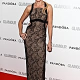 Naomi Watts wowed in a lace Versace column dress with back cutouts.