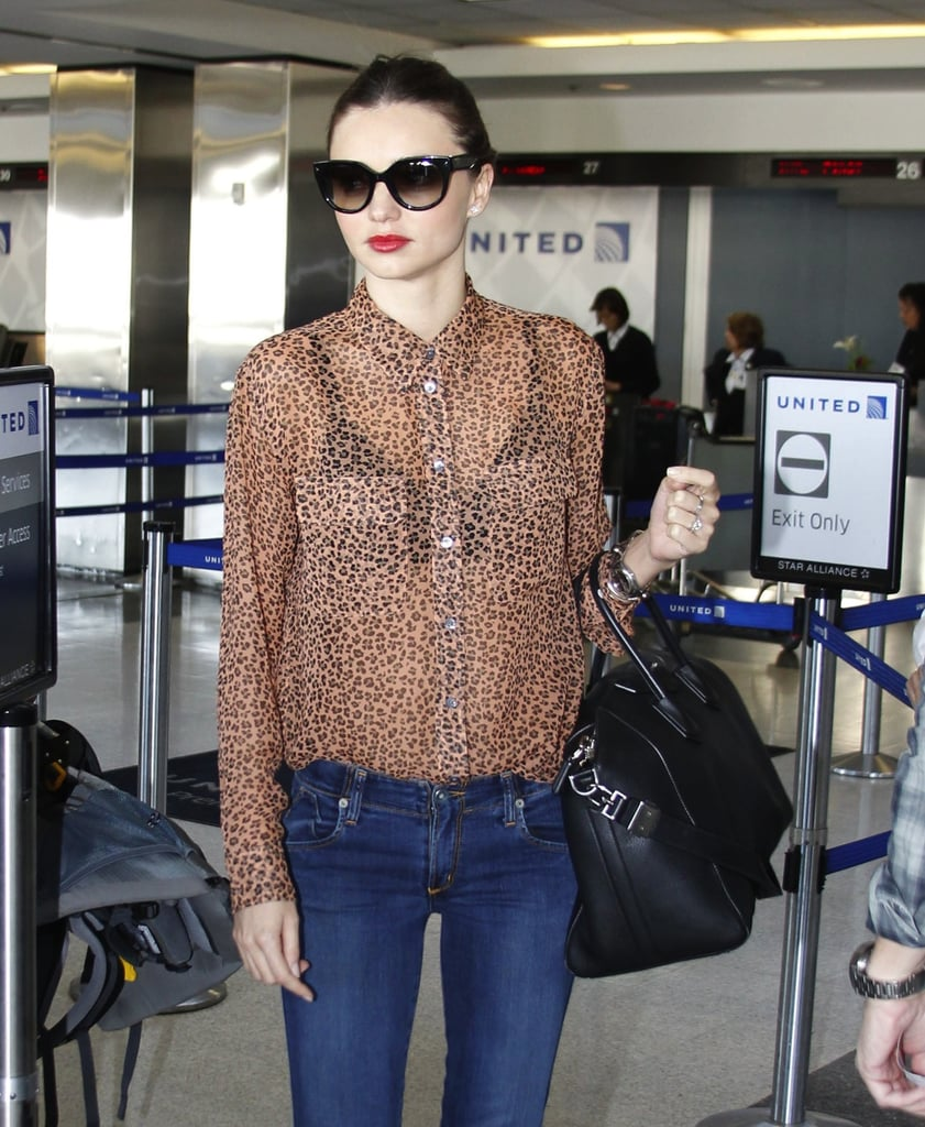 A closer look at Miranda's sheer leopard blouse.