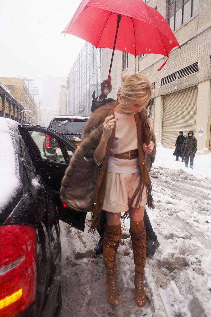 A little NYC blizzard wasn't going to stop this woman's outfit game.