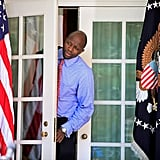 Reggie Love steps out of the West Wing ahead of the president.