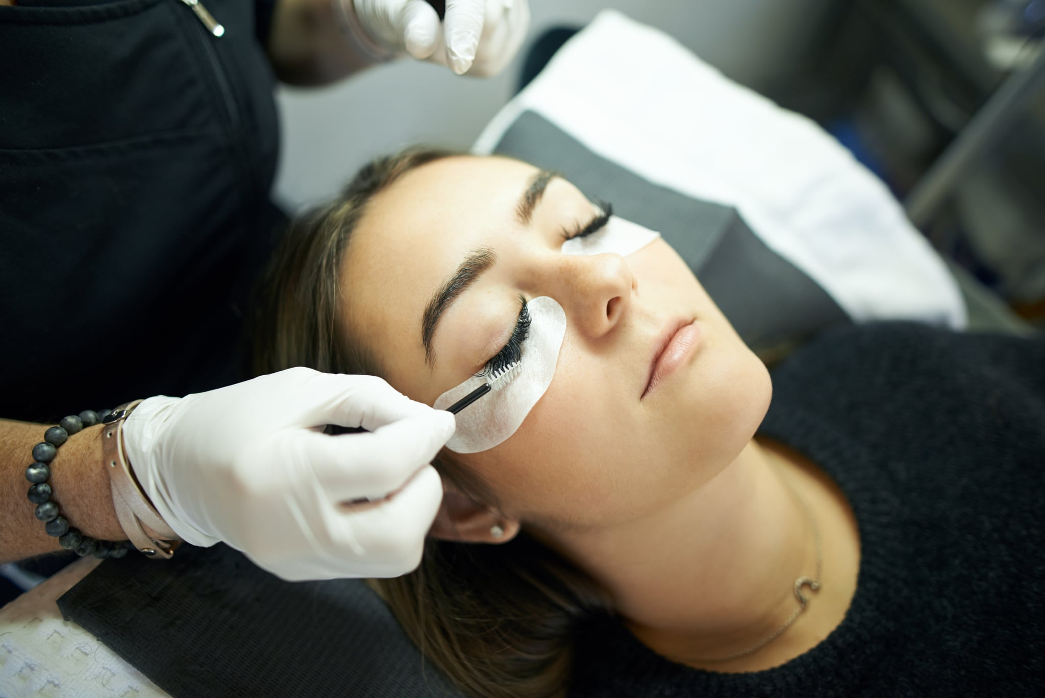 Cropped shot of a young woman getting eyelash extensions