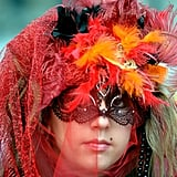 A woman sported a mask for the Carnevale di Venezia spectacle, which dates back to 1162.