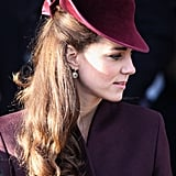 Back in 2011, for Kate's first Christmas Day church service as a member of the Royal Family, she chose a berry velvet hat designed by Jane Corbett.