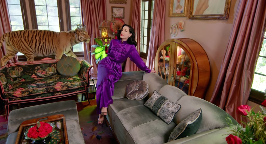 "A pool house pub, an all-pink lounge room, priceless memorabilia, cases of vintage feathers, and a room entirely filled with shoes: Dita Von Teese's home has a lot going on. What it lacks, however, is seating. ""There's really nowhere comfortable to sit in this house,"" the iconic burlesque performer said while offering Architectural Digest a wildly entertaining tour of her Los Angeles-set, English Tudor-style home, where she's lived for five years. Dita's aesthetic, as you can imagine, is heavily inspired by trends of the '30s and '40s, and though it can at times feel like a museum with its many unusual objects and collector's items, her home is also quite lovely, with several airy balconies and a vast backyard. Just, you know, don't expect to sit anywhere. Because there's a lot to process, please enjoy our in-depth look at her home tour video ahead.       Related:                                                                                                           Dakota Johnson's Midcentury-Modern LA Home Is a Relaxing Escape From the Busy City"